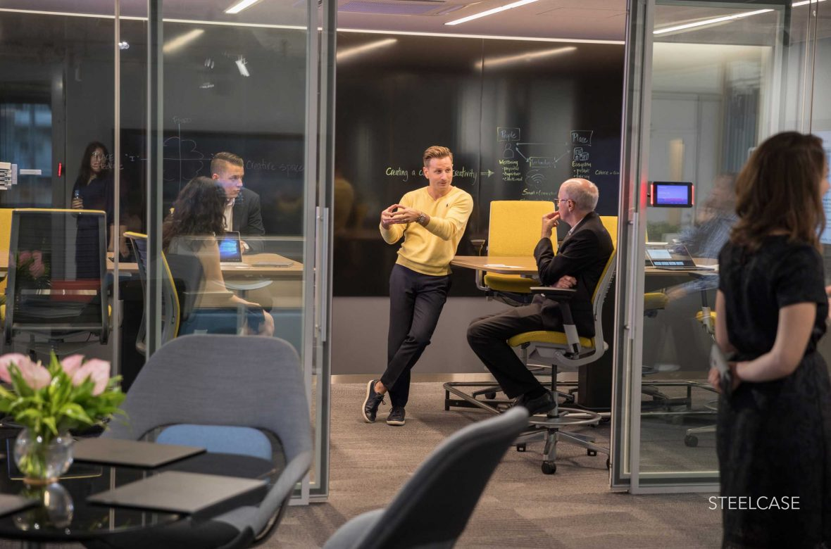 A Steelcase executive makes an important point during a meeting at the Tokyo office.